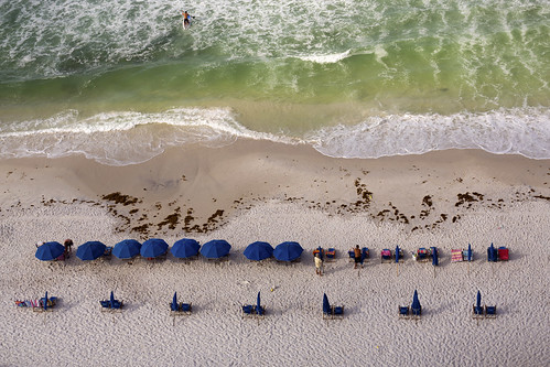 ocean morning sea vacation usa beach nature horizontal umbrella relax outdoors photography sand chair day gulf florida relaxing wave symmetry watersedge vacations scenics distant inarow beachumbrella traveldestinations colorimage paddleboard suf floridausa highangleview incidentalpeople gulfcoaststates