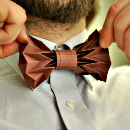 origami bow tie on bearded model wearing dress shirt