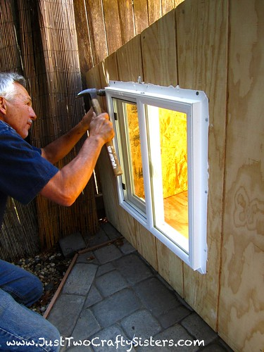 Installing the window in Wezley's dog house