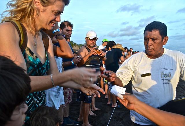 Exchanging ticket for turtle - Monterrico, Guatemala