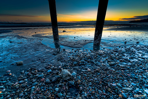 Sunset with pebbles under the pier @ White Rock, BC
