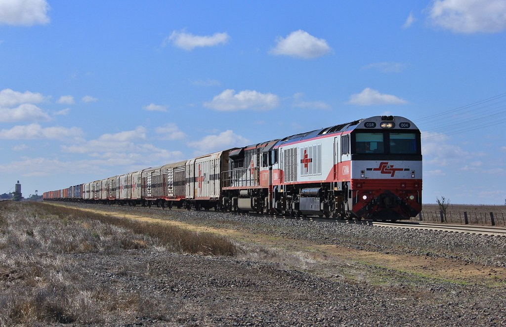 CSR004 and SCT007 ease up as they approach the signal to enter the Dooen freight terminal on 9721V by bukk05