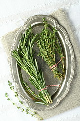 Fresh aromatic herbs rosemary and thyme on metal p…