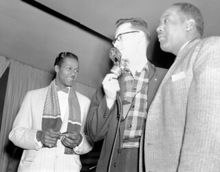 Chuck Berry, an unidentified CHED Radio announcer, and an unidentified performer at the Edmonton Gardens, Alberta