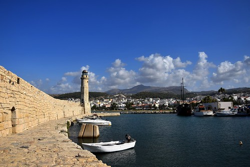 venetianharbourofrethymno rethymno rethymnon crete kriti kreta greece greek harbour old ancient blue rocks stones sky sea mediterranean clouds boats landscape view hills mountains building architecture city urban summer hot
