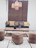 bamboo bank rond vloerkleed houten salontafel rotan lampjes