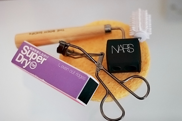 Beauty Tools and Accessories including Cellulose Face Sponges, No7 Lift & Curl Eyelash Curlers, Superdry Nail Buffer Cube, The Body Shop Face Massager and Nars Pencil Sharpener