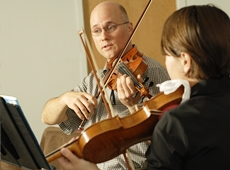 Photo of violin teacher and student