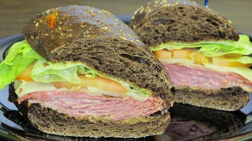 Corned beef and Swiss sandwich on pumpernickel roll by Coyoty