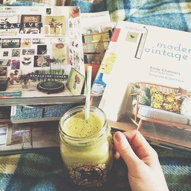 Gigantic green juice with everything in it, and a humongous stack of decorating books from the library. And kitten snuggles of course.