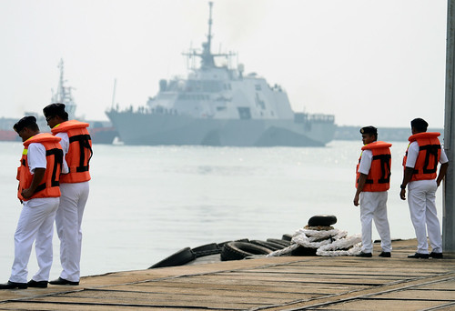 Members of the Royal Malaysian Navy observe the littoral combat ship USS Freedom's (LCS 1) arrival in Kuantan, Malaysia