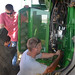 Jason from John Deere fixes our combine while Leon and Kaidence look on