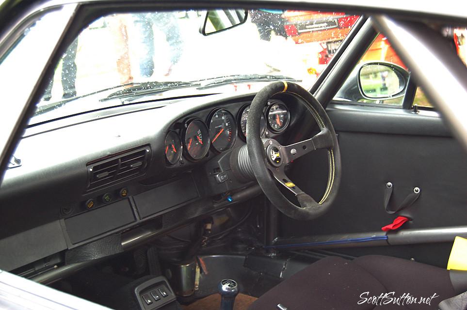 Porsche with a door pull blowing raspberries