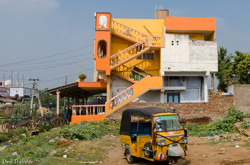 autorickshaw in front of orange house