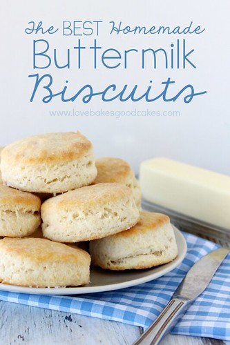 The BEST Homemade Buttermilk Biscuits stacked up on plate with butter and a butter knife.