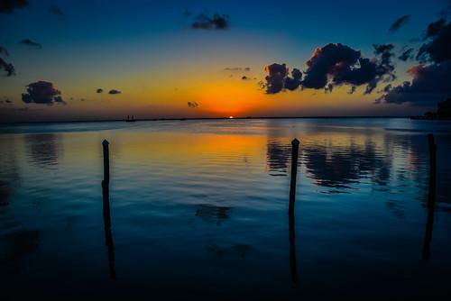 cancún quintanaroo mexico mx sunset lagoon la isla shopping village cancun yucatán yucatan quintana roo riviera maya rivieramaya water caribbean sea ocean gulf cove bay yellow orange sun
