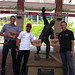 Justin Wilson, Tony Kanaan, and Ed Carpenter with Johnny Bench statue in Cincinnati, Ohio