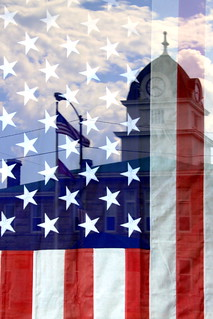 Fentress County Courthouse Reflection Upon US Flag in Store Window - Jamestown, TN