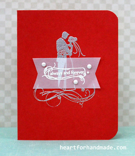 Wedding card with silver and white embossing