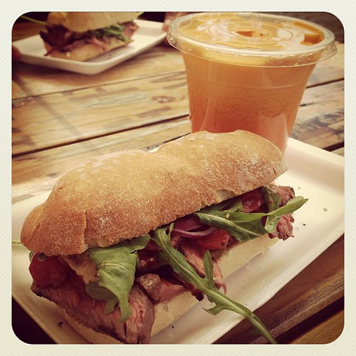 Roasted sirloin with caramelised cherry tomatoes, red onions relish, whole grain mustard & wild rocket. Wow juice - pineapple, carrot, lemon, apple & orange. The best juice I have ever had. From V&A Market on the Wharf.  www.therabbitandtherobin.co.za {fo