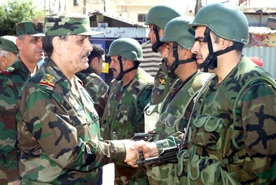 Syrian military officers congratulates troops on efforts to defeat western-backed rebels fighting against the government in Damascus. by Pan-African News Wire File Photos