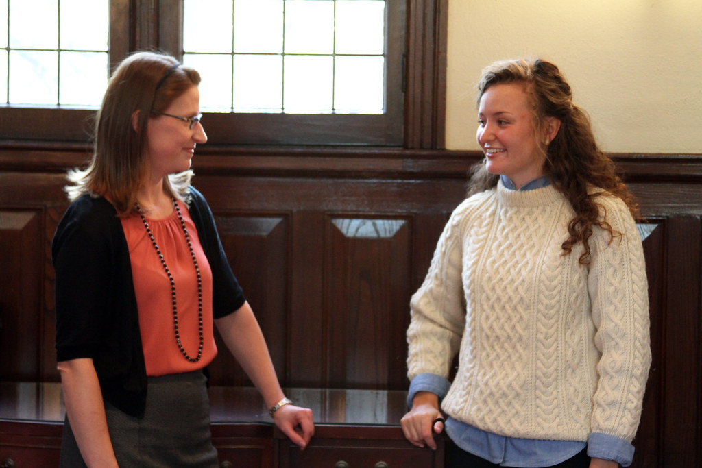 Professor Laura MacManus-Spencer (left) speaks with Maggie Hoffman '14/
