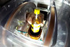 A small bottle of white wine is placed inside the MagRay bottle scanner system.
