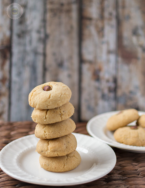 Nani's Pistachio Cardamom Cookies Stacked on a white plate
