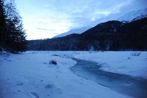 Blue ice, white snow, SixMile River slew, Sunrise Island (on the left), twilight,view south towards mountains on the Kenai Penisula, Turnagain Arm, Sunrise, Alaska, USA by Wonderlane