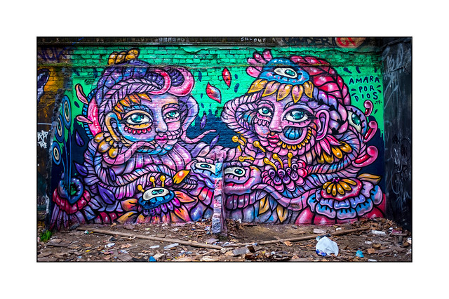Street Art (Amara Por Dios), East London, England.