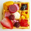 Crunchy and fluffy belgian waffles. Square presentation with fruit and yoghurt
