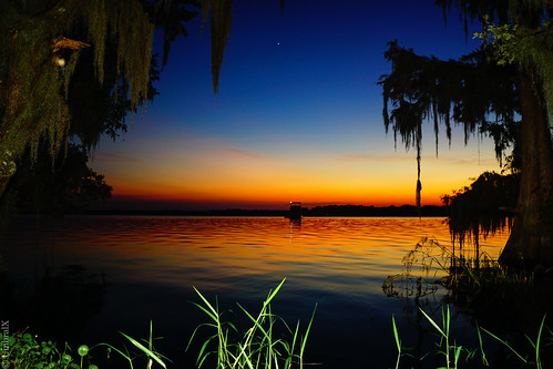 centralflorida deland florida lake water sunset reflection spanishmoss sonyphotography sony a6000 sonya6000 evening glow landscape waves