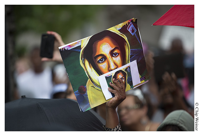 Linda Paulk of Ice Cream Magazine holds portrait of Travon Martin
