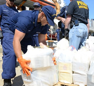 Members from the Coast Guard, Drug Enforcement Agency, Massachusetts State Police and other local and federal law-enforcement agencies offload more than 1,200 pounds of cocaine from the deck of the Coast Guard Cutter Dependable, Sept. 6, 2013. The Coast Guard seized the suspected contraband and detained two suspected smugglers during an at-sea interdiction, Sept. 2, 2013, approximately 500 miles east of Cape Cod. The drug shipment is estimated to have a wholesale value of more than $20 million. U.S. Coast Guard photo by Petty Officer 2nd Class Rob Simpson.
