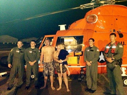 Life jackets may have saved the lives of two Ellabell, Ga., adults and their son (center), who were were hoisted from Ossabaw Island, Ga., by a Coast Guard helicopter crew Sunday, Sept. 15, 2013. The family reported to the aircrew they put their life jackets on and attempted to swim to shore after their boat began taking on water, but they got swept out to sea with the outgoing tide and drifted in Ossabaw Sound and the Atlantic Ocean for about two hours before the tide shifted, pushing them back toward Ossabaw Island. (U.S. Coast Guard photo by Lt. Kelly Winslow)