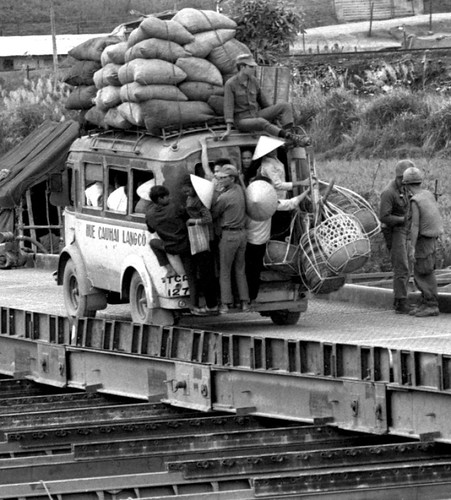 A Gerard Forken photo downloaded from Stars and Stripes: Seabees' new bridge in Vietnam gets a test. 1967 by busboy4