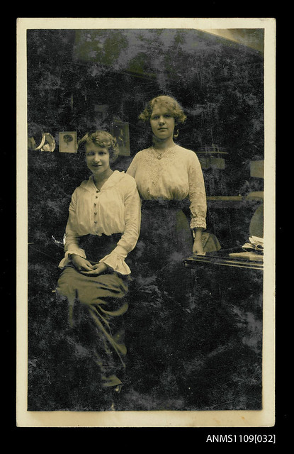 Photographic postcard of sisters Helen Dorothy and Ethel Manila Sterling on E R STERLING