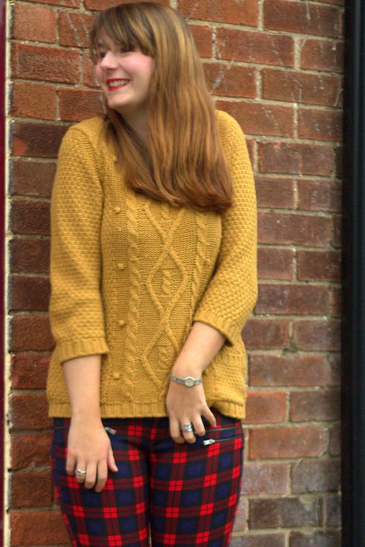 Mustard coat, mustard jumper, tartan trousers, heels
