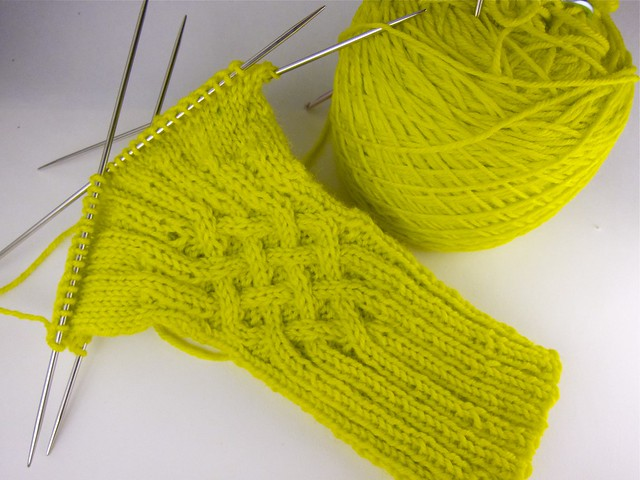 Knotty cabled gloves in progress (in chartreuse merino sock yarn)