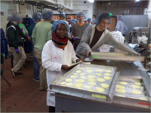 Tei Mukunya tests solar drying technology for fruit in a lab with Michigan State University Biosystems Engineering students. Mukunya recently completed a 12-week Borlaug Fellowship at MSU to study the technology to help improve her agribusiness and the livelihood of Kenyan farmers. (Courtesy Photo)