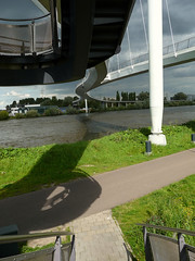 View on the construction of  the Nescio-brug over the heavily shipped canal Amsterdam-Rijn-kanaal; a new pedestrian and cyclists bridge, connecting the city Amsterdam and the new northerly residential area IJburg; urban photography, Fons Heijnsbroek, 2011