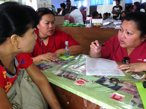 Girlie Garnada (R) working in a clinic with RN Jane Sandoval (R)