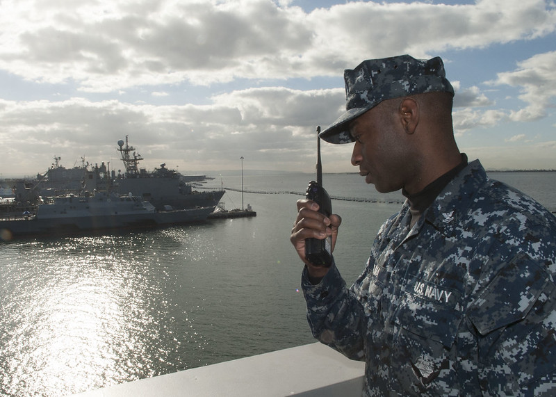 SAN DIEGO - Boatswain's Mate 2nd Class Bandy Dasilma, assigned to Deck department aboard San Antonio-class amphibious transport dock USS Anchorage (LPD 23), oversees an underway replenishment at sea drill during a ship's fast cruise.