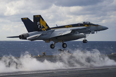 An F/A-18E Super Hornet from the Eagles of Strike Fighter Squadron (VFA) 115 takes off from USS George Washington (CVN 73) during Carrier Air Wing (CVW) 5's fly-off, Dec. 1. (U.S. Navy photo by Mass Communication Specialist 3rd Class Ricardo R. Guzman)