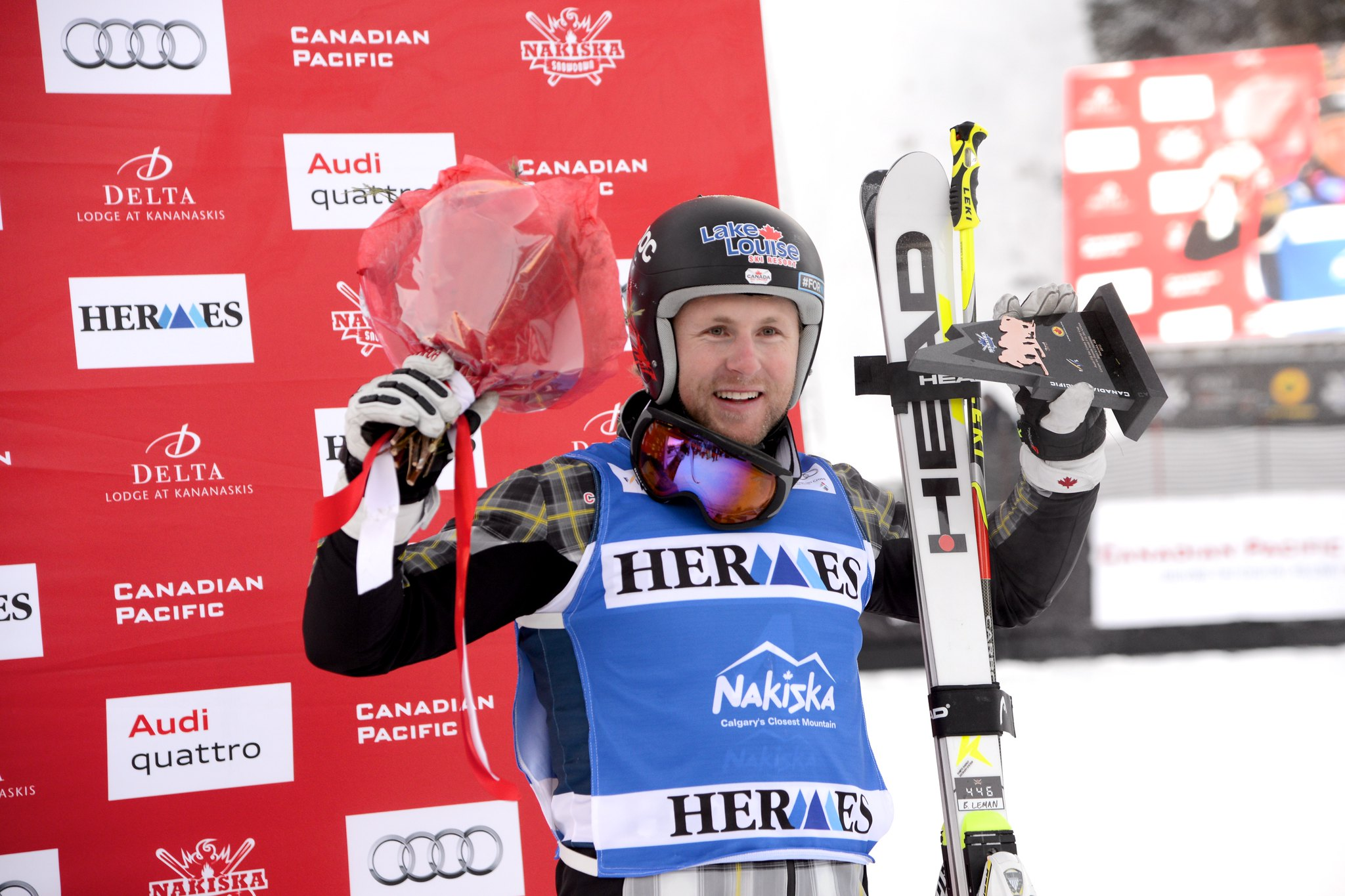 Brady Leman celebrates a 3rd place finish at the FIS Ski Cross World Cup in Nakiska, CAN