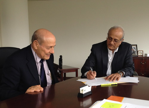 NIFA Director Dr. Sonny Ramaswamy, right, and Edo Chalutz, executive director of the U.S.–Israel Binational Agricultural Research and Development Fund, sign a memorandum of understanding (MOU) on November 22.  The MOU promotes, supports and expands the robust agricultural research and development on-going between the two countries.  (Photo by Julia Lewis)