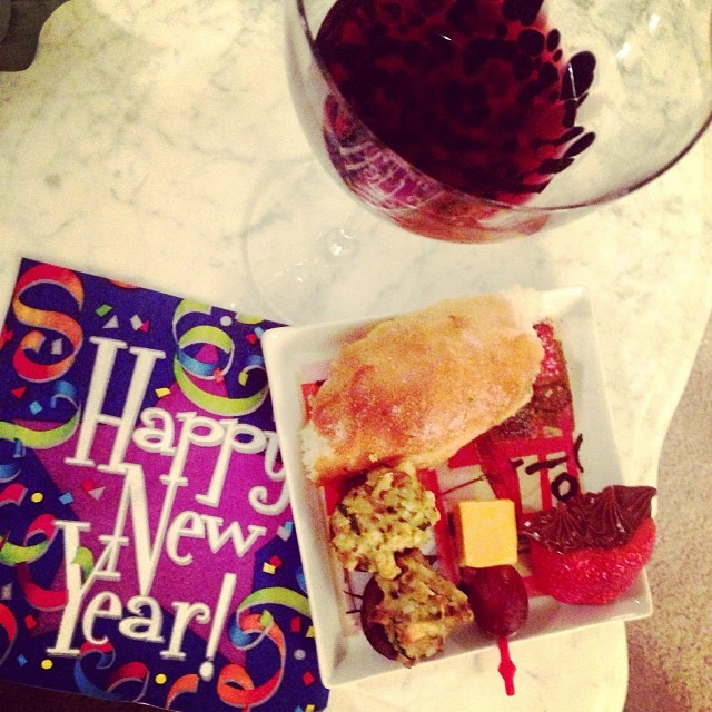 Happy New Year!!! Loving all the finger foods, ciabatta bread, grape and cheese skewer, stuffed shrooms, Nutella stuffed strawberries and a big glass of red wine... And lots more!!! Happy New Year!!!' 2014 is going to be a great year!!!!