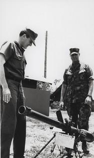 Secretary of the Navy John Chafee Examines an Enemy Weapon, 1969