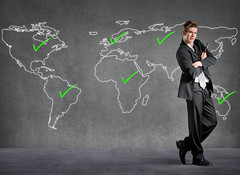 Businessman checked places on a world map