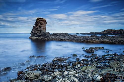 ocean longexposure sea cliff stone clouds landscape iceland rocks stones kelp shore westfjords arneshreppur nordurfjordur arnarbergur